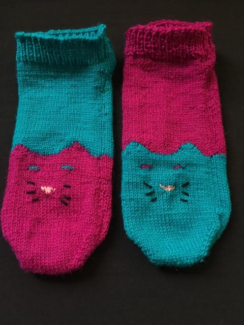 191)  Sooooo cute! Hand knitted pair of socks in plum and teal